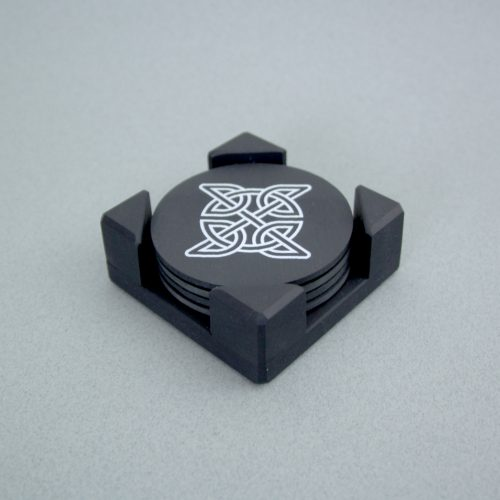 A set of Round Blue Grey Welsh Slate Coasters printed with Celtic Designs and placed in a slate Coaster Holder