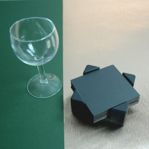 A set of Square Blue Grey Welsh Slate Coasters placed in a slate Coaster Holder