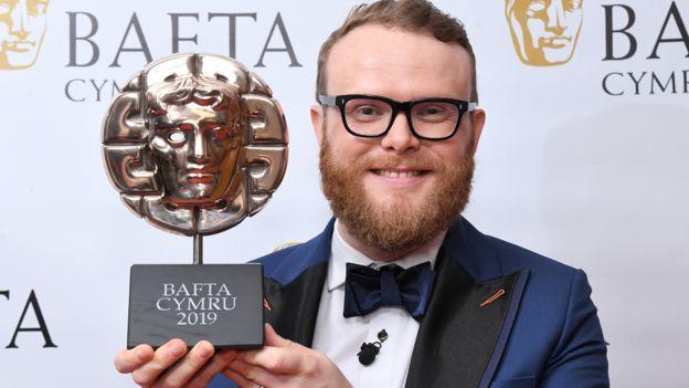 Huw Stephens with his Welsh Slate BAFTA Cymru 2019 Award