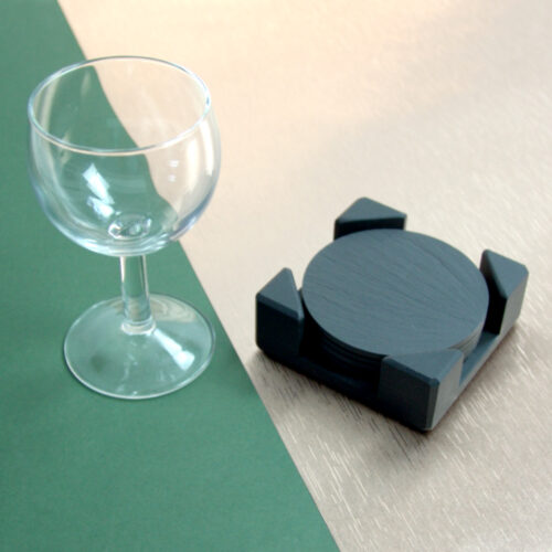 A set of Round Blue Grey Welsh Slate Coasters placed in a slate Coaster Holder