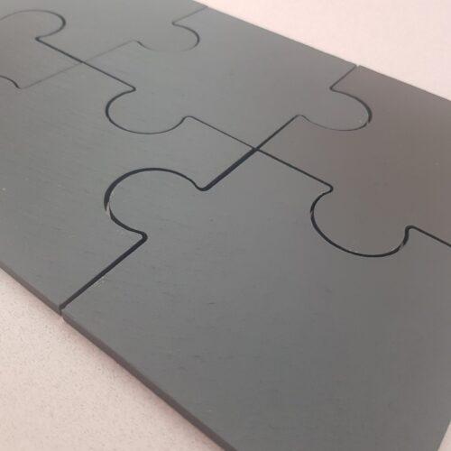 riven textured detailing of welsh slate jigsaw Coasters by Inigo Jones Slate Works