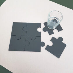 partially pieced together set of 6 welsh slate jigsaw Coasters by Inigo Jones Slate Works