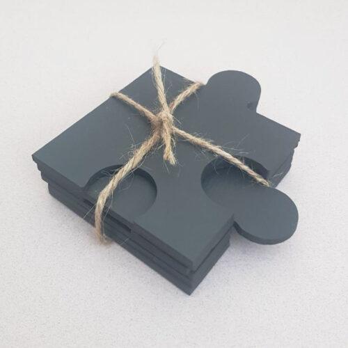 twine wrapped up set of 6 jigsaw shaped welsh slate Coasters by Inigo Jones Slate Works